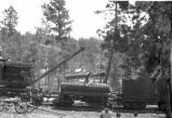 Loading log on train a Cloudcroft Lumber and Land Company railroad car near Cloudcroft, New Mexico